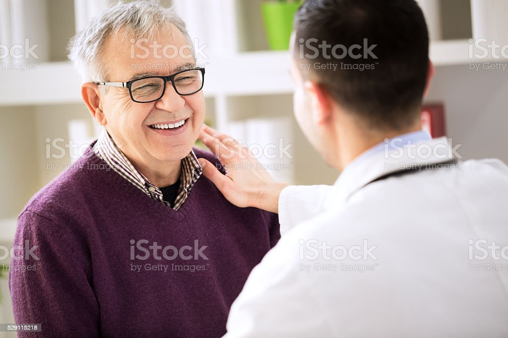 Smiling happy patient visit doctor stock photo
