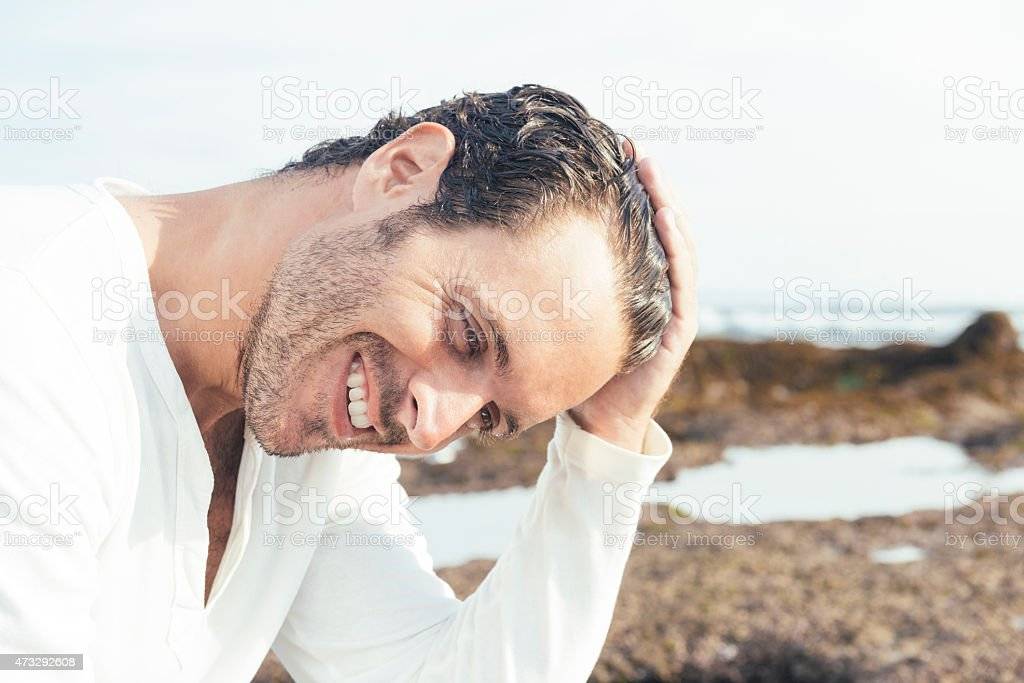 Smiling Happy Sexy Man on Tropical Beach in Bali Indonesia stock photo