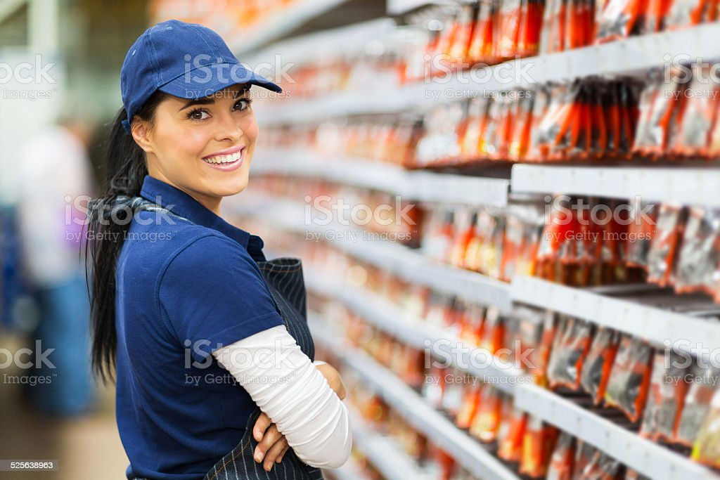 smiling hardware store worker stock photo