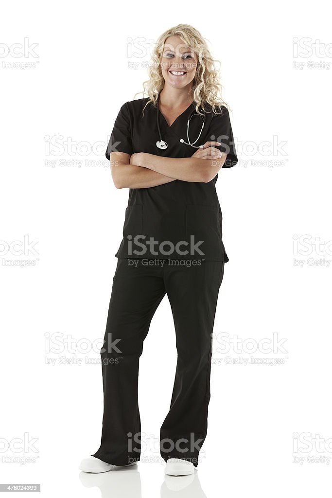Smiling healthcare worker standing with arms crossed royalty-free stock photo