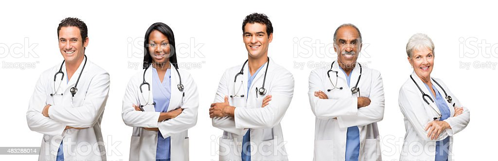 Smiling healthcare workers with their arms crossed stock photo