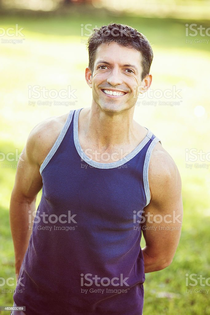 Smiling healthy man in purple tank top royalty-free stock photo