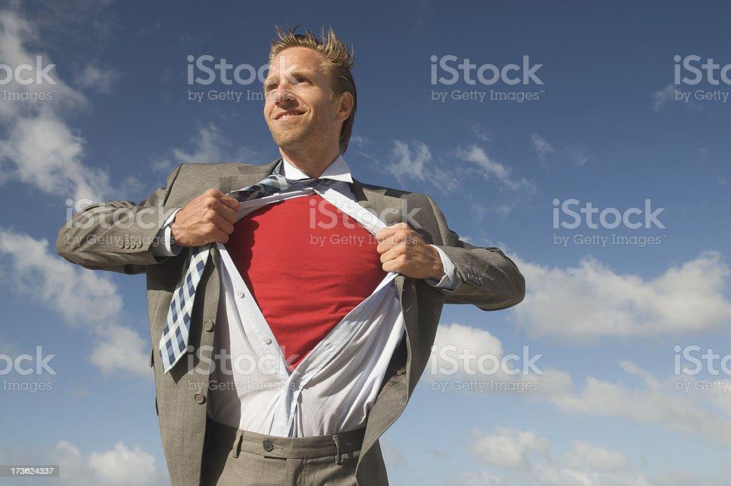 Smiling Heroic Superhero Businessman to the Rescue Blue Sky royalty-free stock photo