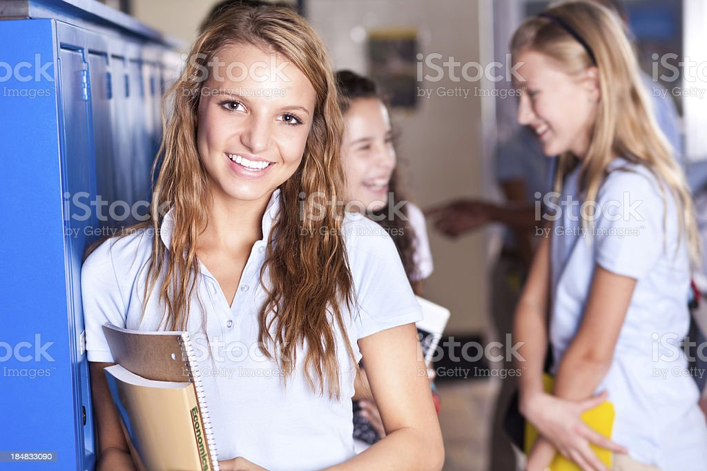 Smiling High School student at her  locker royalty-free stock photo