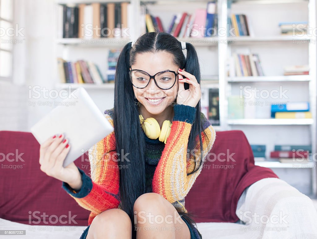 Smiling high school student holding digital tablet stock photo