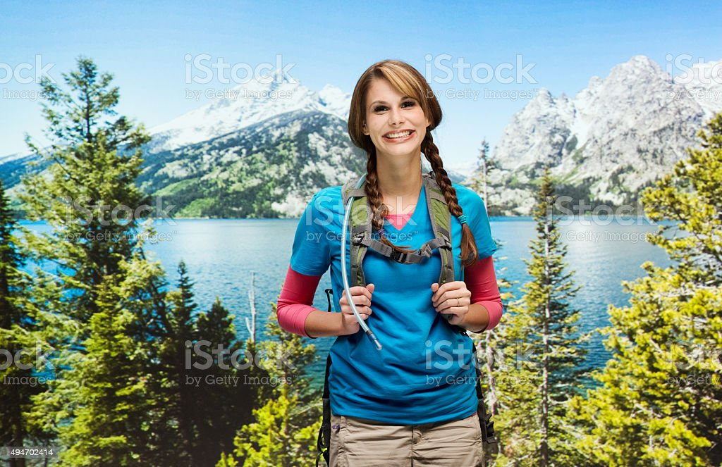 Smiling hiker at the wilderness area stock photo