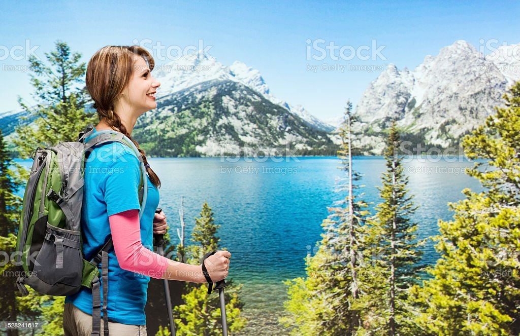 Smiling hiker in front of rural scene stock photo