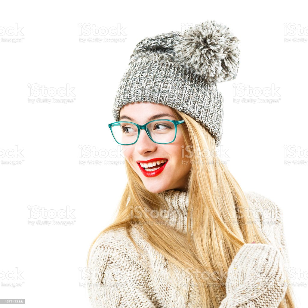 Smiling Hipster Girl in Winter Sweater and Hat on White stock photo