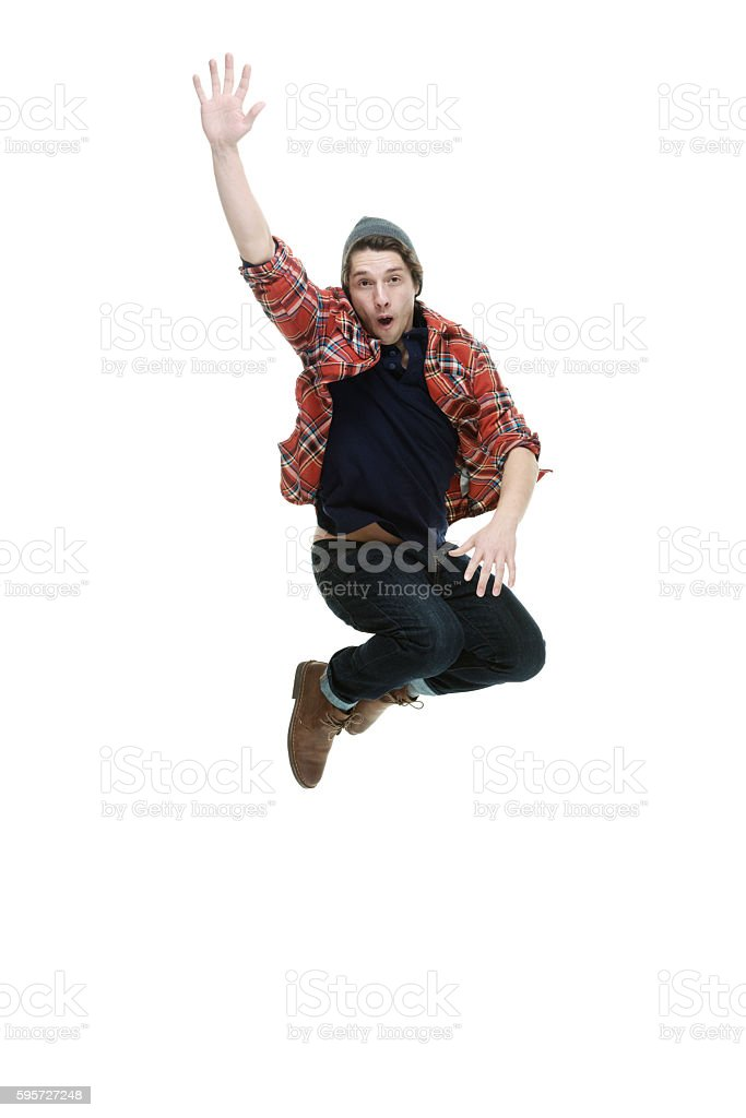 Smiling hipster jumping stock photo
