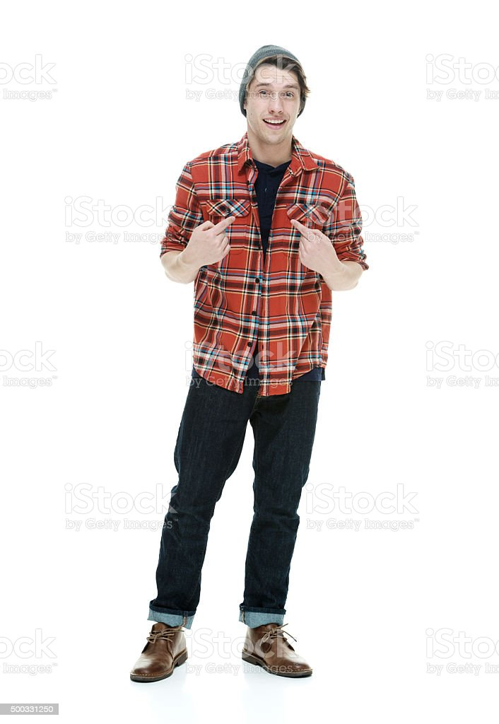 Smiling hipster pointing at himself stock photo