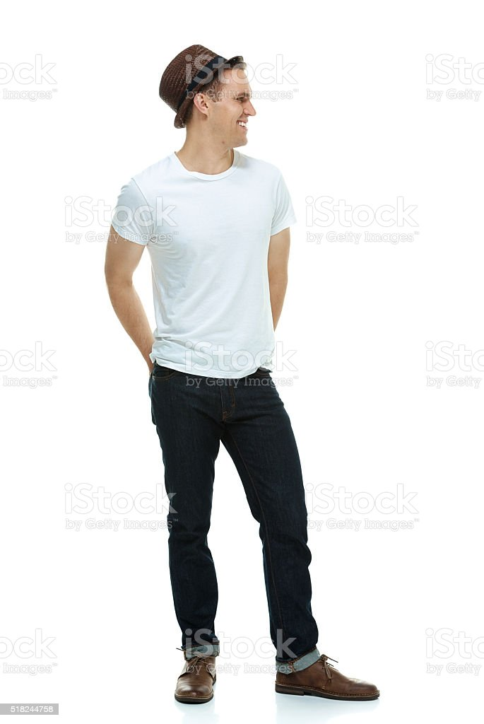 Smiling hipster standing and looking away stock photo