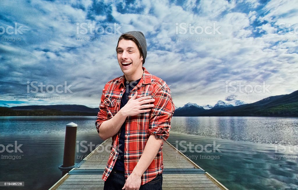 Smiling hipster standing wilderness area stock photo