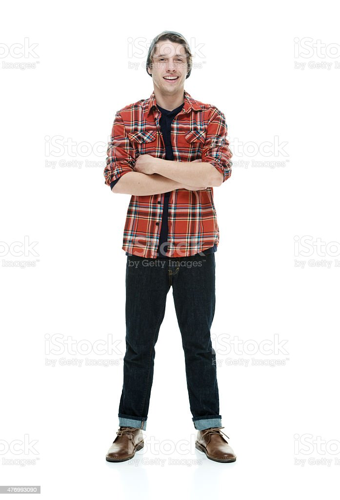 Smiling hipster standing with arms crossed stock photo