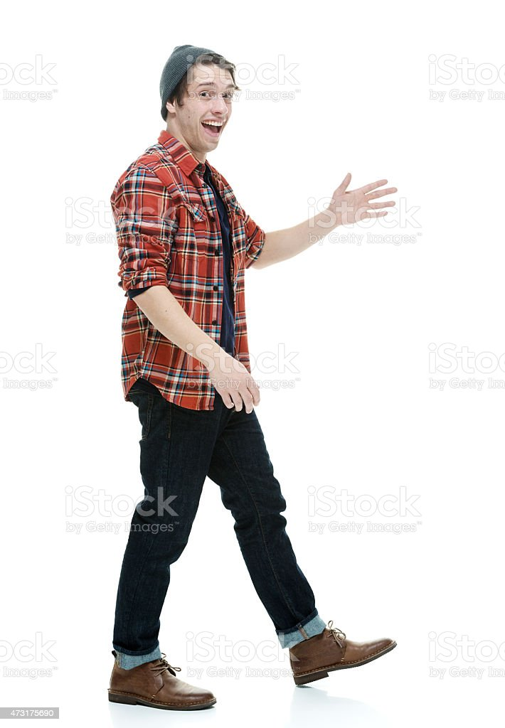 Smiling hipster waving hand stock photo