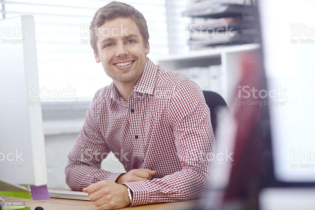 Smiling his way through work stock photo