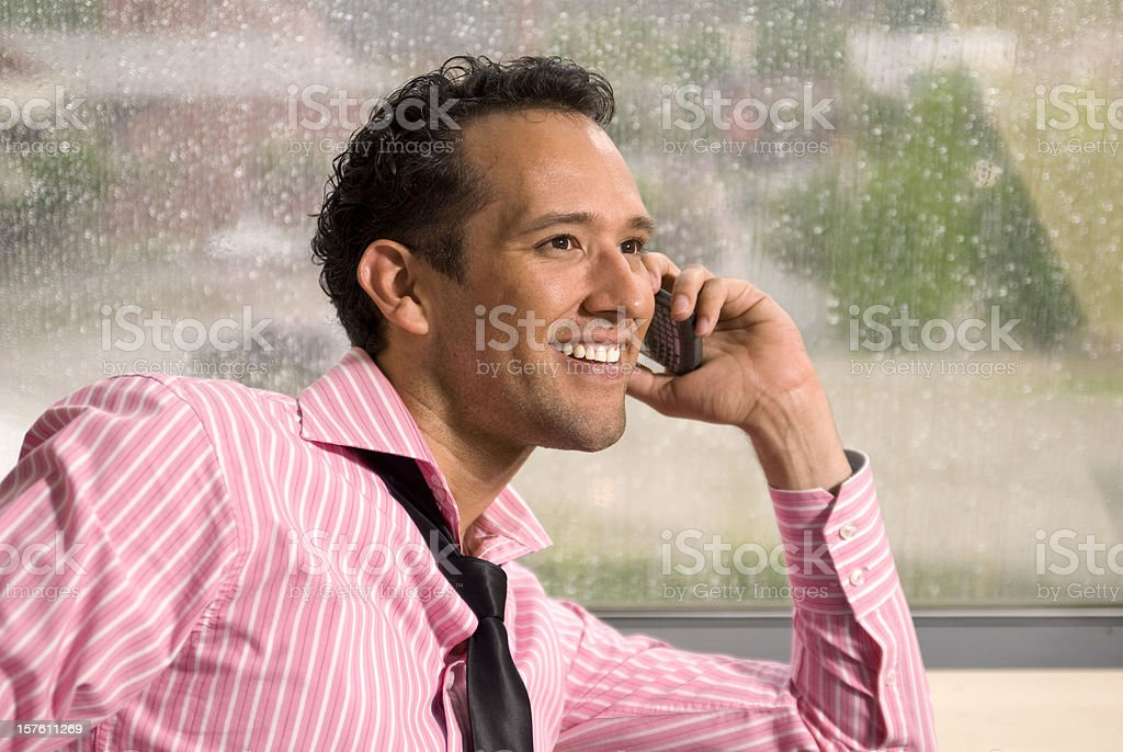 Smiling Hispanic Businessman, Man Working in Business Office & Telephone Talking royalty-free stock photo