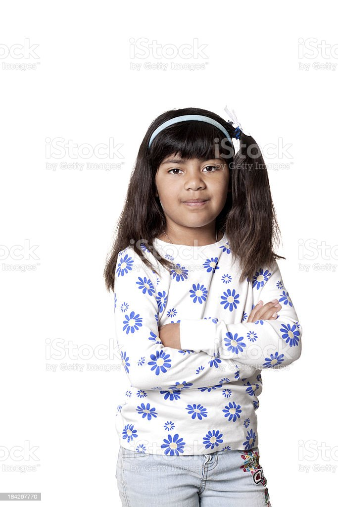 Smiling Hispanic Girl with Arms Crossed stock photo