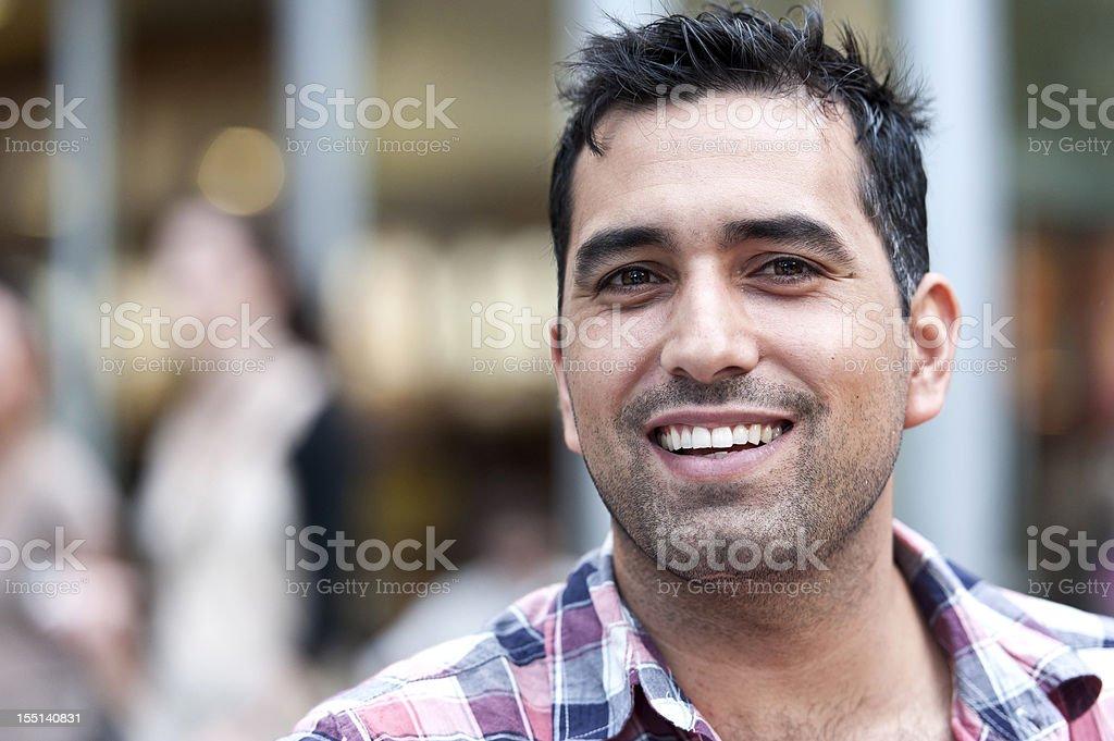Smiling hispanic man stock photo