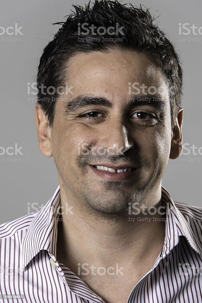Smiling hispanic man royalty-free stock photo
