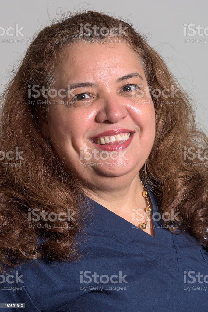 Smiling hispanic mature woman stock photo