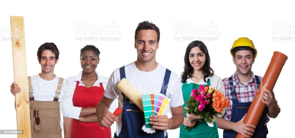Smiling hispanic painter with group of other international apprentices stock photo