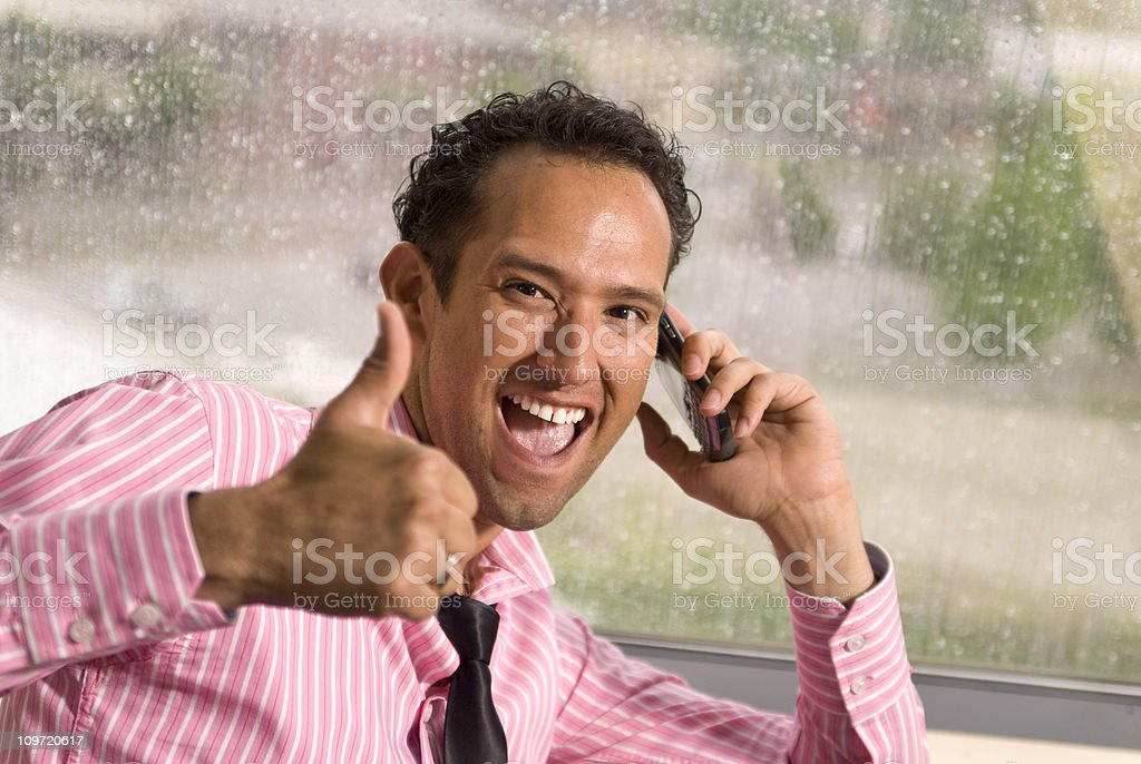 Smiling Hispanic Successful Businessman on Telephone: Salesman Giving Thumbs Upe royalty-free stock photo