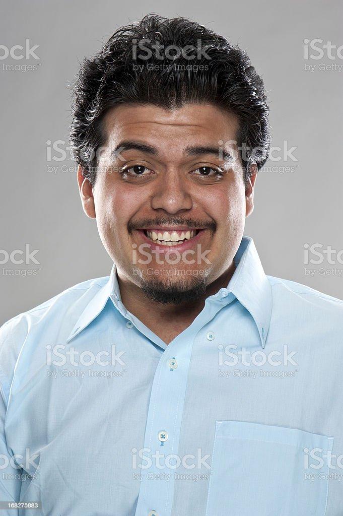 Smiling hispanic young man (real people) royalty-free stock photo