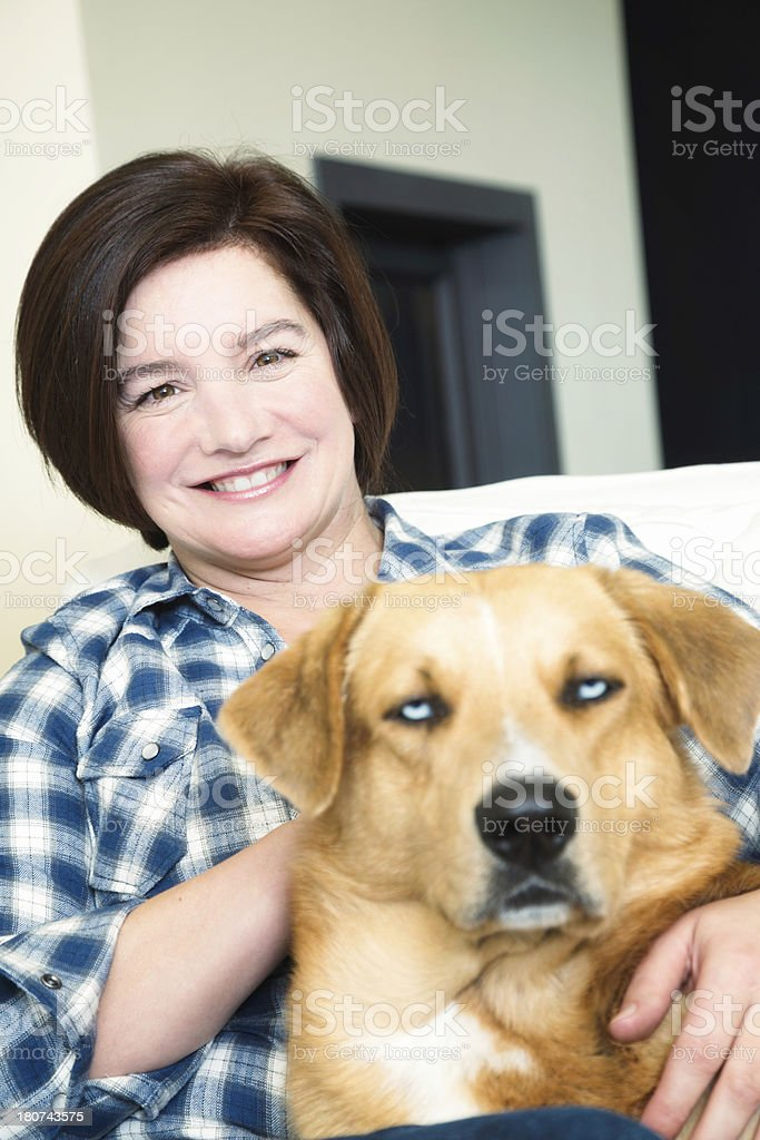 Smiling housemom portrait with her grumpy dog royalty-free stock photo