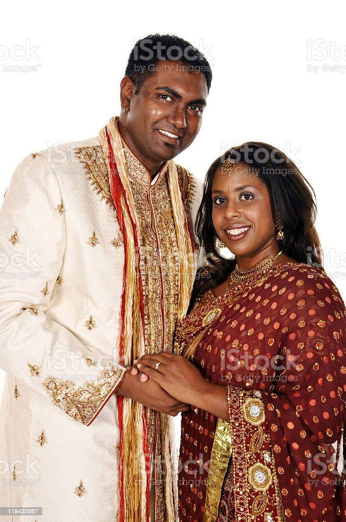 Smiling Indian Bridal Couple Holding Hands Isolated on White stock photo