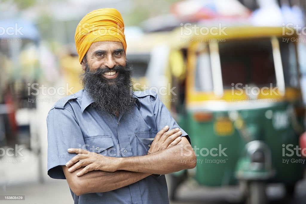 A smiling Indian rickshaw driver stock photo