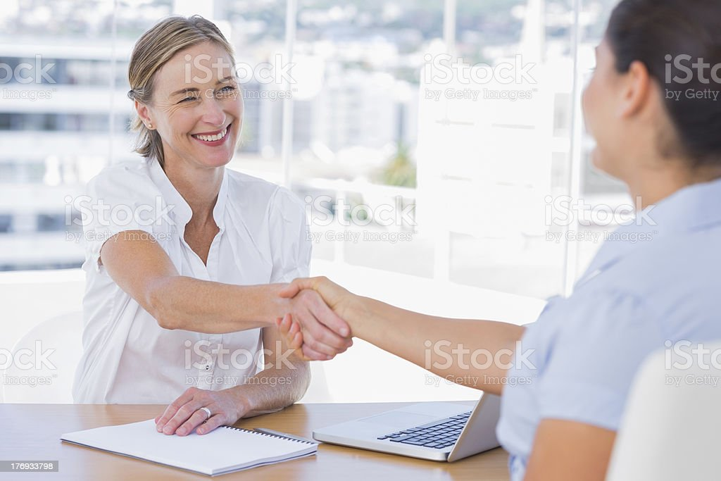Smiling interviewer shaking hand of an applicant royalty-free stock photo