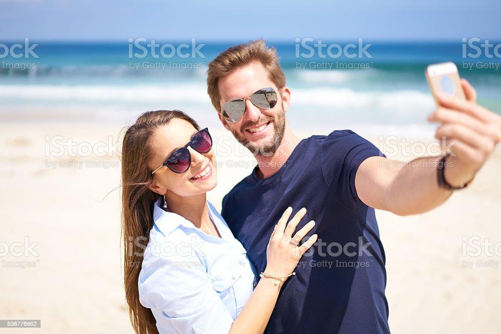 smiling into smartphone stock photo
