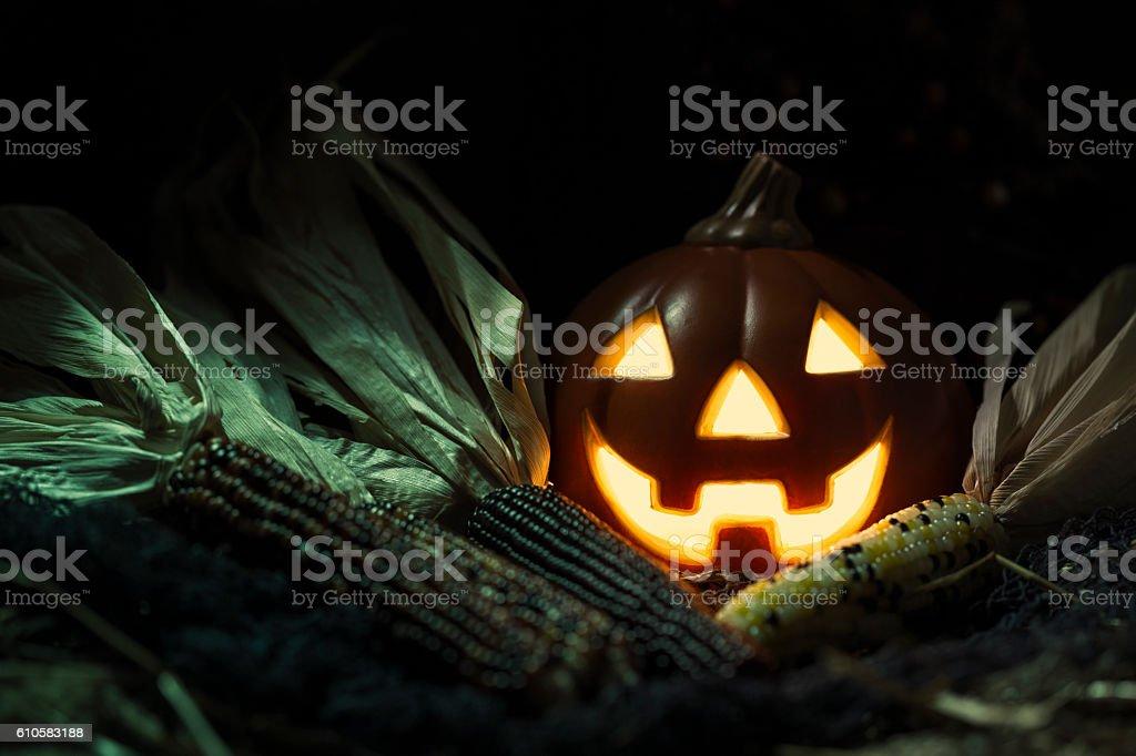 Smiling Jack O' Lantern and Indian Corn stock photo