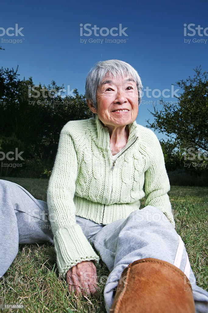 Smiling Japanese Grandma Sitting Outside stock photo