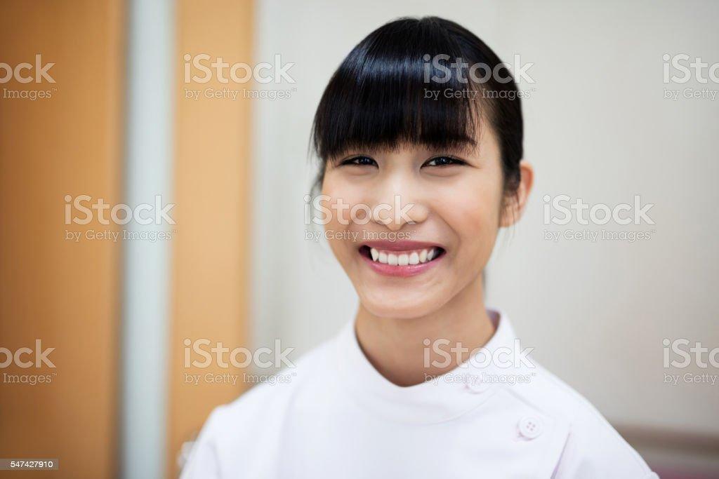 smiling japanese nurse in hospital stock photo