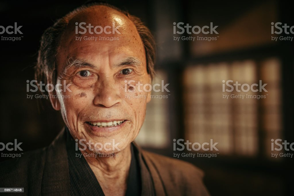 smiling Japanese senior in traditional clothes stock photo