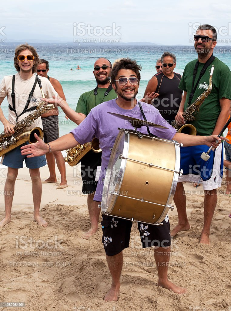 Smiling Jazz Band on the beach stock photo