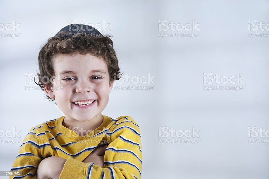 Smiling Jewish boy in striped yellow shirt stock photo