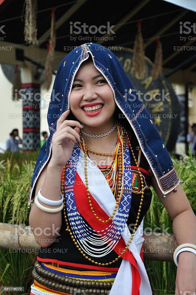 Smiling Kadazan Dusun girl in traditional costume stock photo