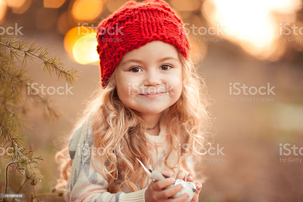 Smiling kid girl outdoors stock photo