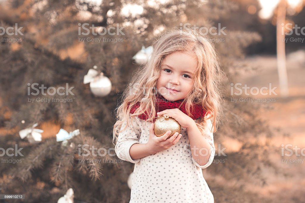 Smiling kid girl with christmas decorations stock photo