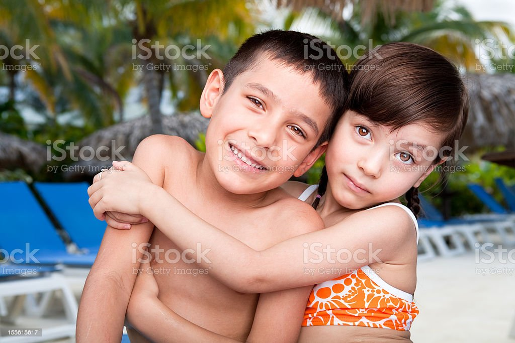 Smiling kids at the beach royalty-free stock photo