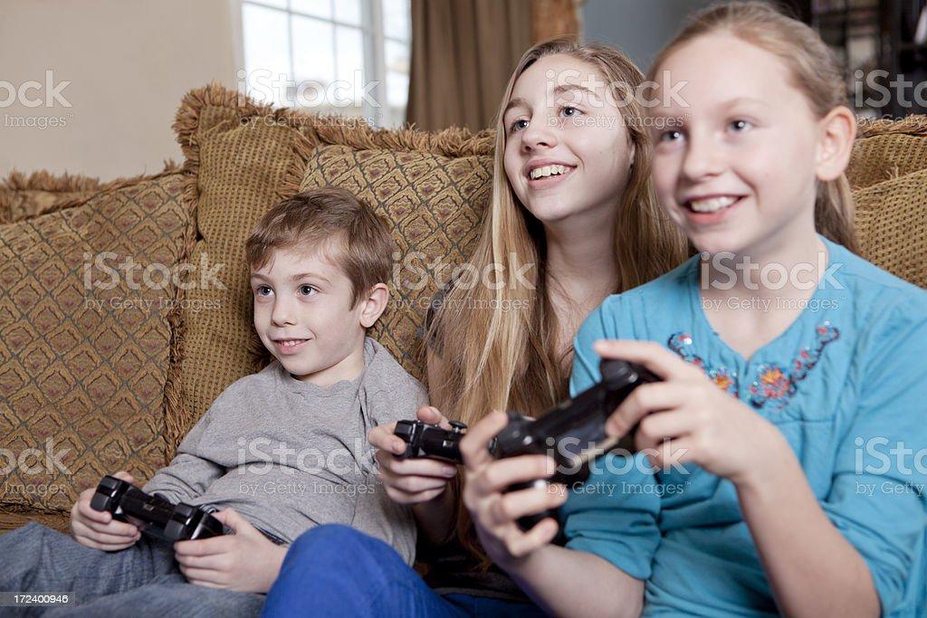 Smiling Kids Playing Video Games royalty-free stock photo