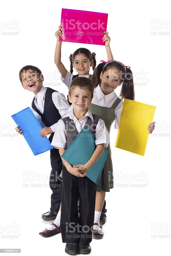 Smiling kids standing with folders stock photo