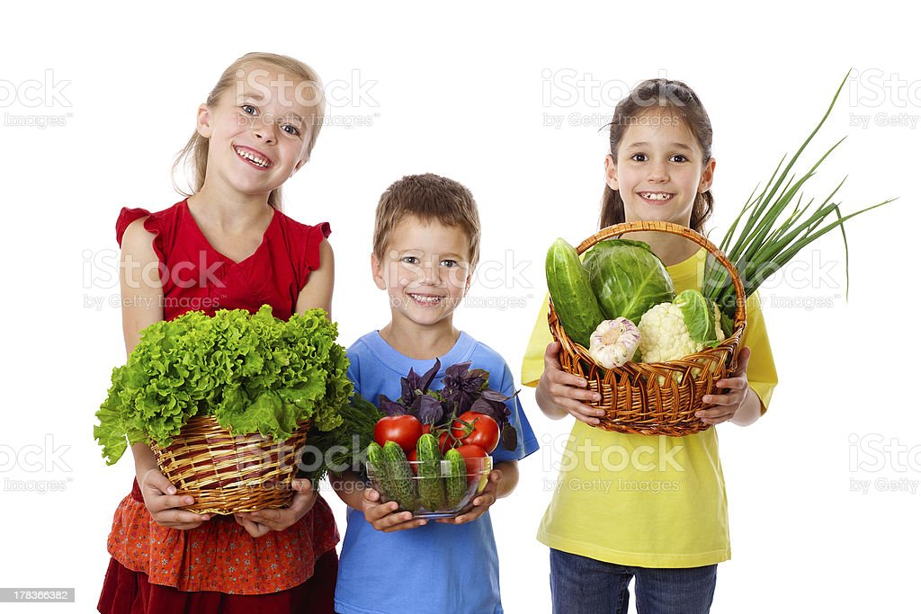 Smiling kids with fresh vegetables royalty-free stock photo