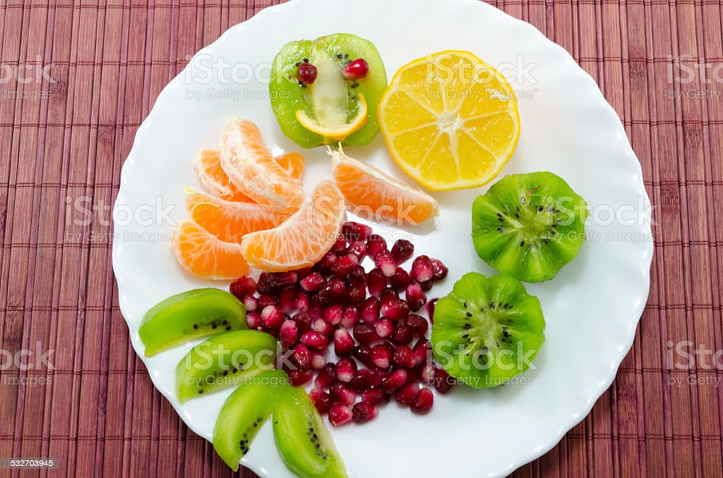 Smiling kiwi and various sliced fruit royalty-free stock photo