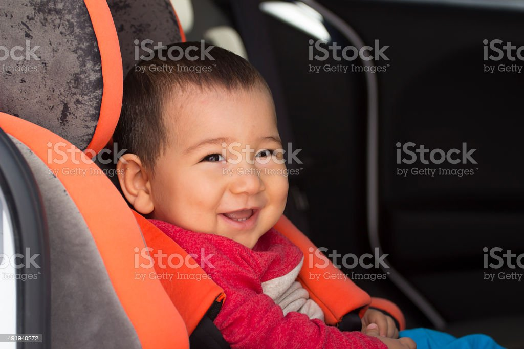 Smiling Korean and Japanese baby on the car stock photo