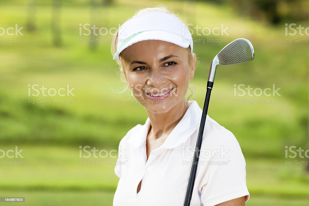 Smiling lady golfer with golf club. royalty-free stock photo