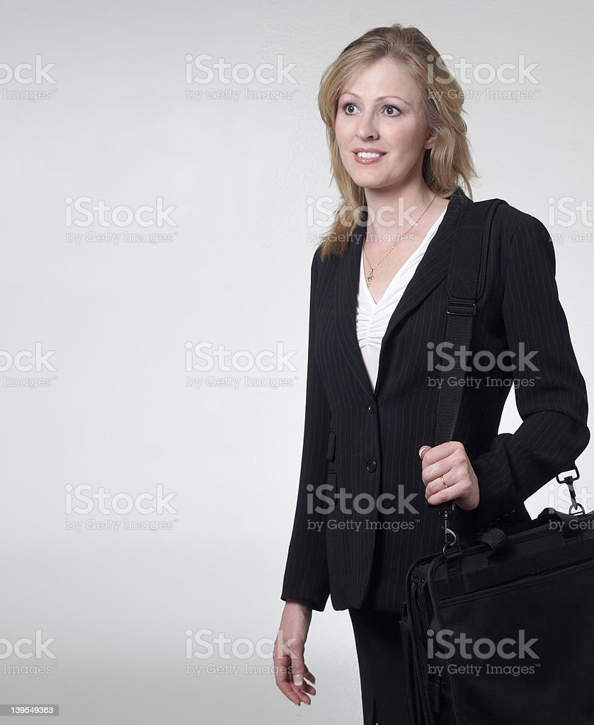 smiling lady lawyer carrying briefcase stock photo