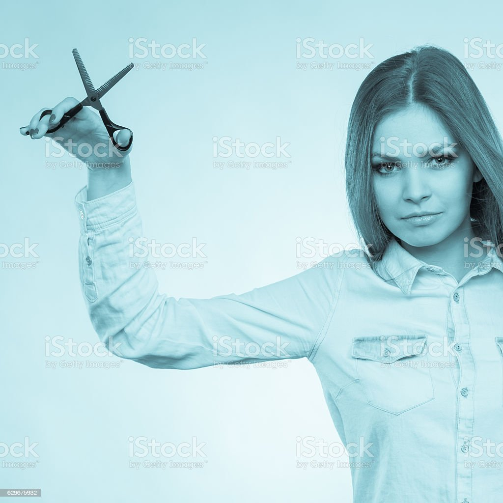 Smiling lady showing tools. stock photo